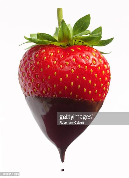 Delicious ripe strawberry dipped in dark chocolate