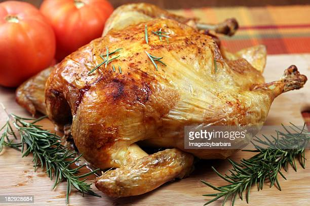 A delicious roasted chicken with tomatoes