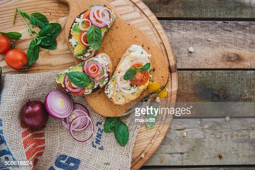 delicious sandwiches on wooden tablet light : Stock Photo