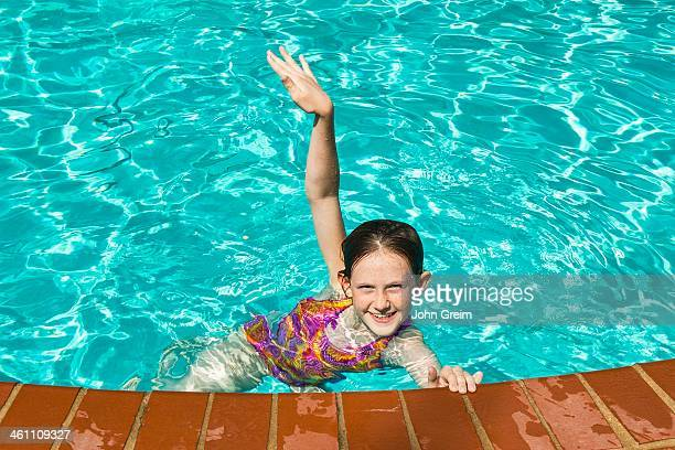 Delighted girl in a swimming pool
