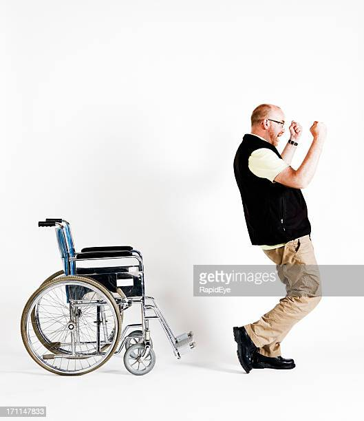 Delighted man rises from wheelchair, able to walk