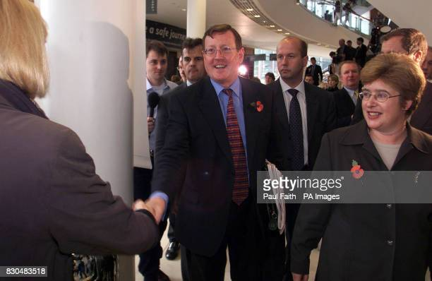 A delighted Ulster Unionist leader David Trimble centre is congratulated by supporters as he leaves Belfast Waterfront Hall after narrowly winning...