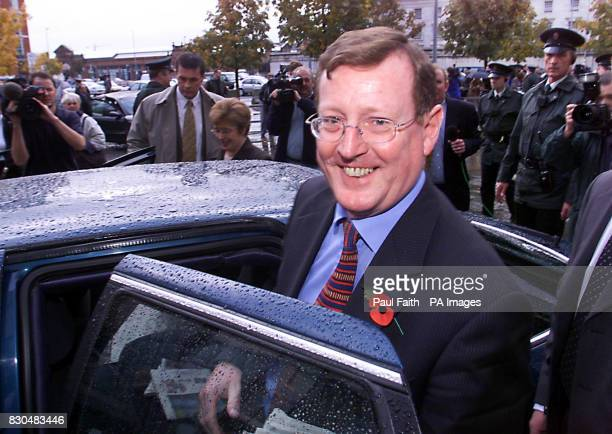 A delighted Ulster Unionist leader David Trimble leaves Belfast Waterfront Hall after narrowly winning party support to keep Northern Ireland's...