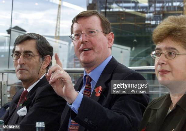 A delighted Ulster Unionist leader David Trimble with party Chairman Lord Rogan and Trimble's wife Daphne speaking at Belfast Waterfront Hall after...