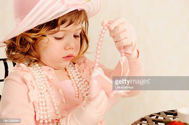 Delightful Little Girl Playing Dress Ups and Tea Party