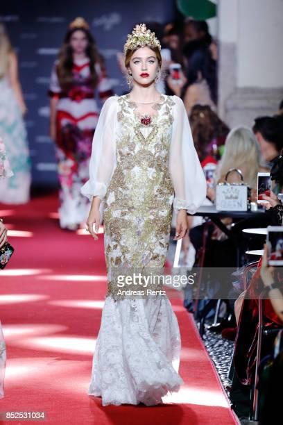 Delilah Belle walks the runway at the Dolce Gabbana secret show during Milan Fashion Week Spring/Summer 2018 at Bar Martini on September 23 2017 in...