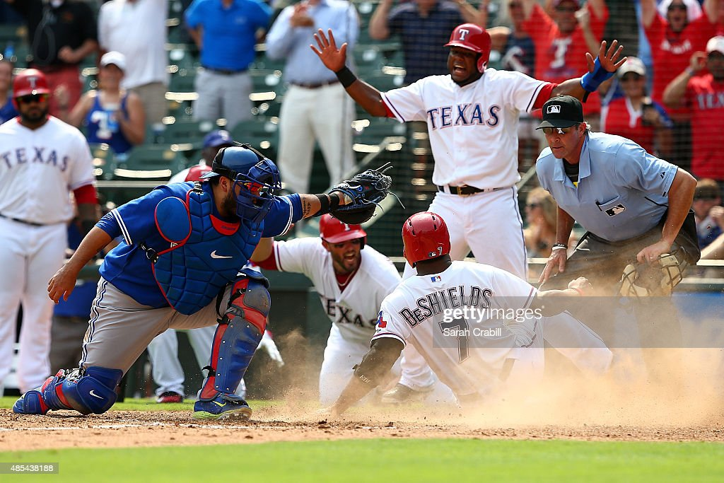 Delino DeShields #7 of the Texas Rangers advances to home on an error in the seventh inning during a game against the Toronto Blue Jays at Globe Life Park in Arlington on August 27, 2015 in Arlington, Texas. The Texas Rangers defeated the Toronto Blue Jays 4-1.