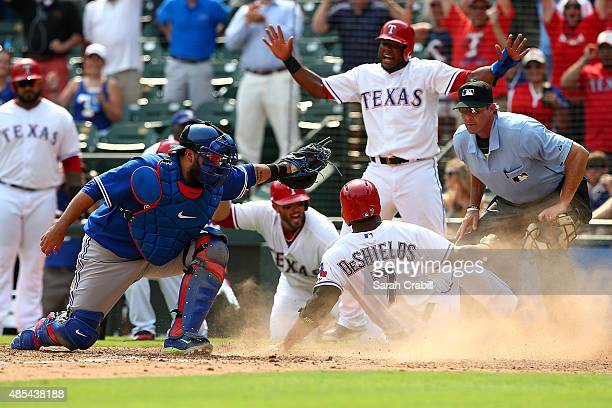 Delino DeShields of the Texas Rangers advances to home on an error in the seventh inning during a game against the Toronto Blue Jays at Globe Life...