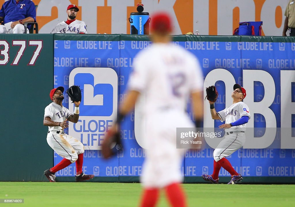 Delino DeShields #3 of the Texas Rangers and Shin-Soo Choo #17 run for a fly ball in the ninth inning against the Chicago White Soxat Globe Life Park in Arlington on August 19, 2017 in Arlington, Texas.
