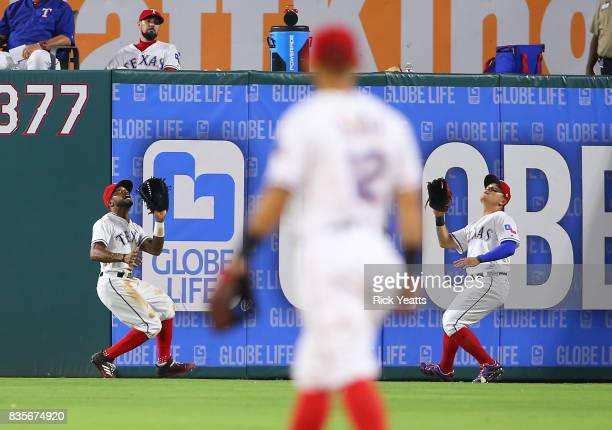Delino DeShields of the Texas Rangers and ShinSoo Choo run for a fly ball in the ninth inning against the Chicago White Soxat Globe Life Park in...