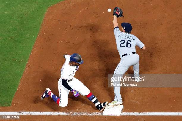 Delino DeShields of the Texas Rangers beats the throw to Danny Valencia of the Seattle Mariners at first base in the second inning at Globe Life Park...