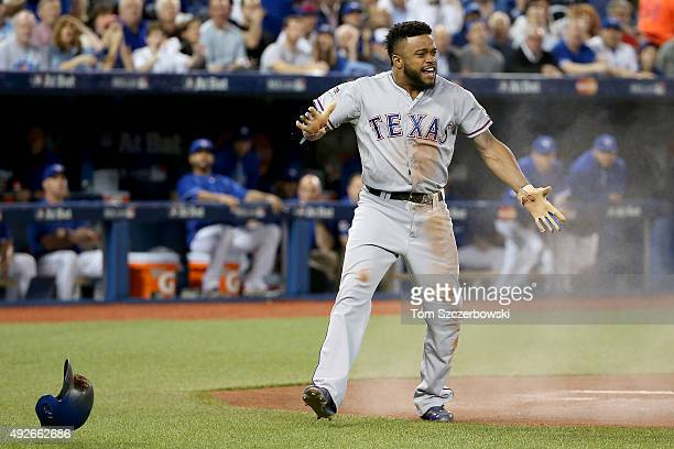 Delino DeShields of the Texas Rangers celebrates after scoring a run in the first inning against the Toronto Blue Jays in game five of the American...