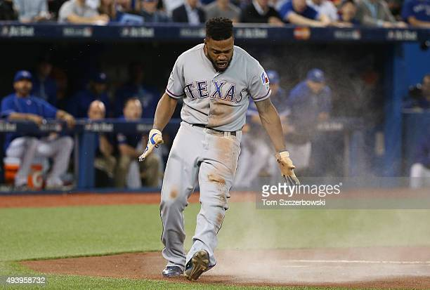 Delino DeShields of the Texas Rangers celebrates after scoring a run in the first inning against the Toronto Blue Jays during game five of the...