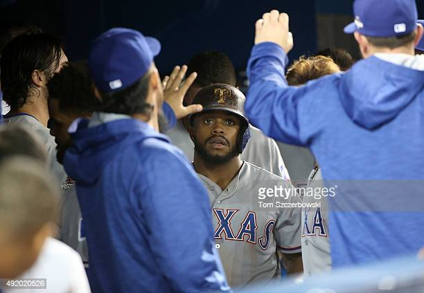Delino DeShields of the Texas Rangers celebrates scoring the tying run in the eighth inning against the Toronto Blue Jays during game two of the...