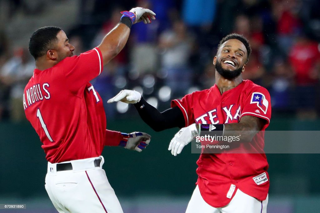Delino DeShields #3 of the Texas Rangers celebrates with Elvis Andrus #1 of the Texas Rangers after hitting the game winning RBI single against the Kansas City Royals in the bottom of the 13th inning at Globe Life Park in Arlington on April 20, 2017 in Arlington, Texas.