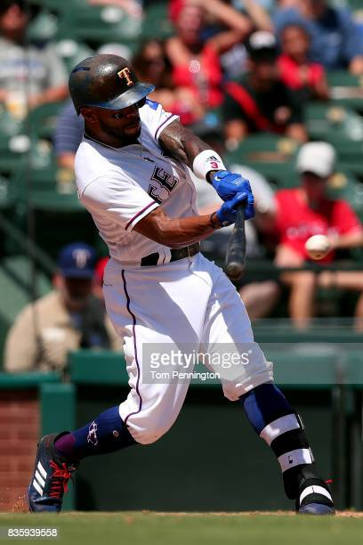 Delino DeShields of the Texas Rangers hits a single against the Chicago White Sox in the bottom of the third inning at Globe Life Park in Arlington...