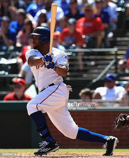 Delino DeShields of the Texas Rangers hits a tworun single against the Los Angeles Angels in the fourth inning at Globe Life Park in Arlington on May...
