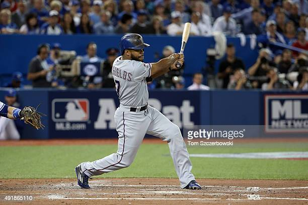 Delino DeShields of the Texas Rangers hits an RBI single to score Rougned Odor in the third inning against David Price of the Toronto Blue Jays...