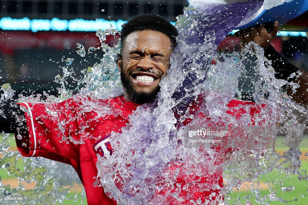 Delino DeShields #3 of the Texas Rangers is doused with Powerade after hitting the game winning RBI single against the Kansas City Royals in the bottom of the 13th inning at Globe Life Park in Arlington on April 20, 2017 in Arlington, Texas.