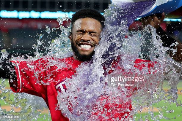 Delino DeShields of the Texas Rangers is doused with Powerade after hitting the game winning RBI single against the Kansas City Royals in the bottom...
