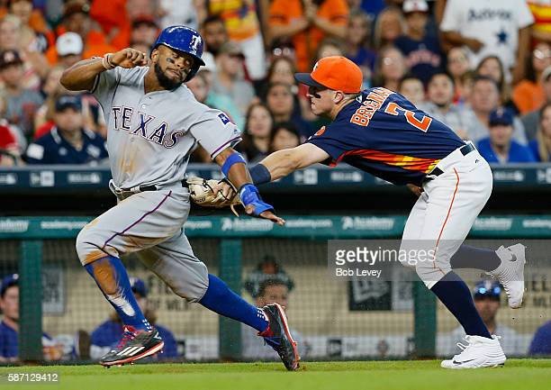 Delino DeShields of the Texas Rangers is tagged out by Alex Bregman of the Houston Astros after being caught in a run down in the eighth inning at...