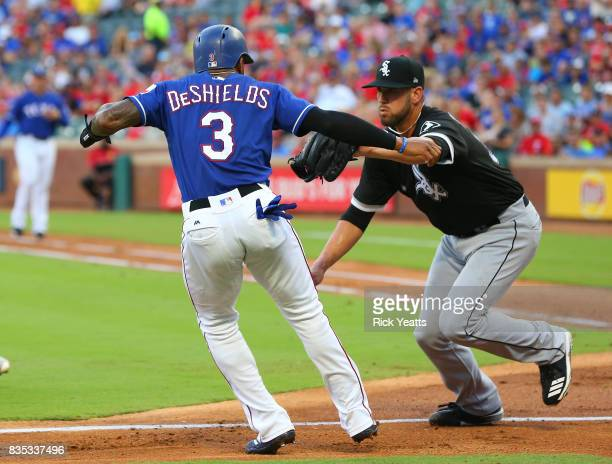 Delino DeShields of the Texas Rangers is tagged out in a run down by James Shields of the Chicago White Sox in the first inning at Globe Life Park in...
