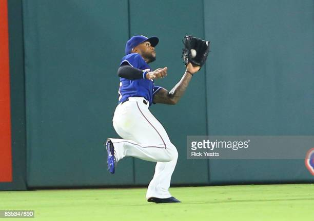 Delino DeShields of the Texas Rangers makes a running catch in the eighth inning against the Chicago White Sox at Globe Life Park in Arlington on...
