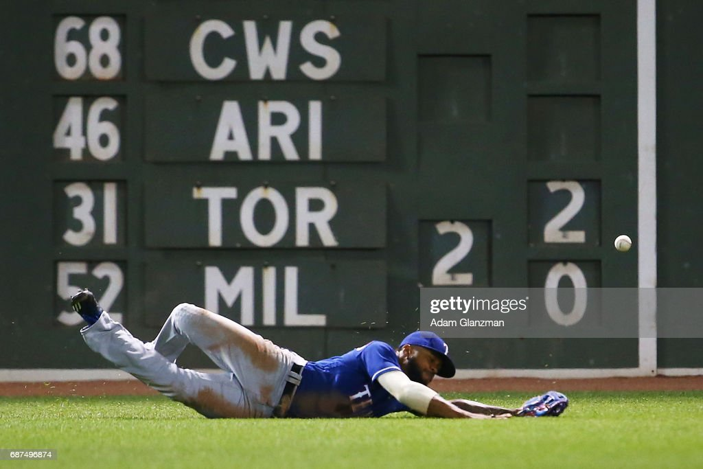 Delino DeShields #3 of the Texas Rangers misses a fly ball in sixth inning of a game against the Boston Red Sox at Fenway Park on May 23, 2017 in Boston, Massachusetts.