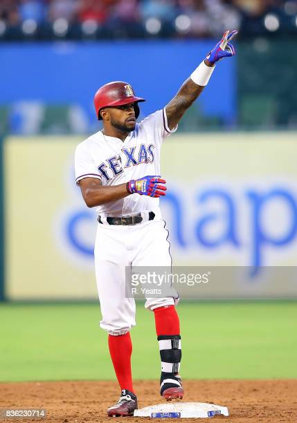 Delino DeShields of the Texas Rangers points to the dugout after hitting a double against the Chicago White Sox at Globe Life Park in Arlington on...