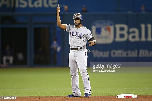 Delino DeShields of the Texas Rangers reacts after hitting a double in the first inning against the Toronto Blue Jays in game five of the American...