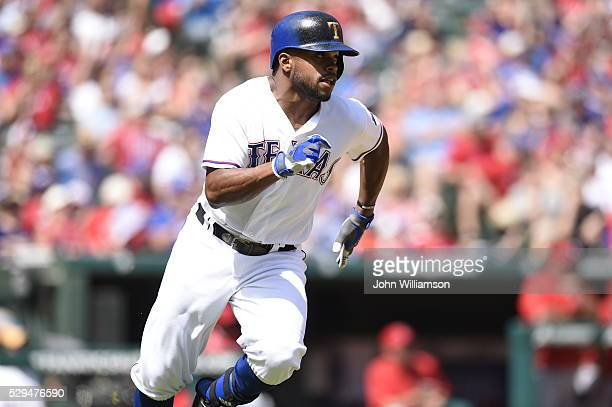 Delino DeShields of the Texas Rangers runs to first base after hitting the ball in the game against the Los Angeles Angels of Anaheim at Globe Life...