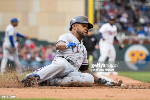 Delino DeShields of the Texas Rangers slides against the Minnesota Twins on August 3 2017 at Target Field in Minneapolis Minnesota The Rangers...