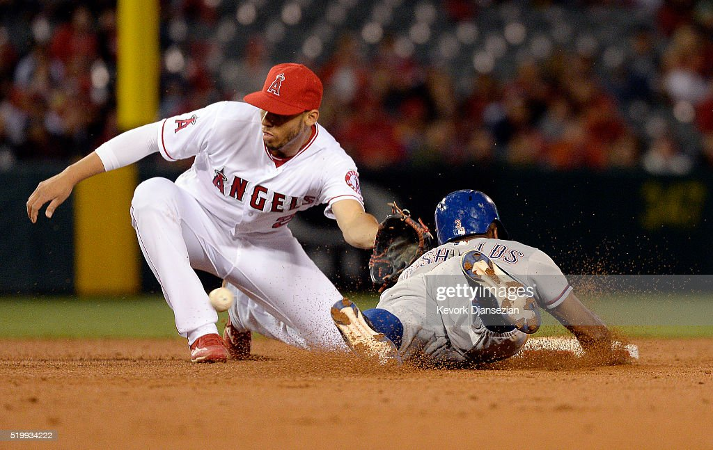 Delino DeShields #3 of the Texas Rangers steals second base as <a gi-track='captionPersonalityLinkClicked' href=/galleries/search?phrase=Andrelton+Simmons&family=editorial&specificpeople=8978424 ng-click='$event.stopPropagation()'>Andrelton Simmons</a> #2 of the Los Angeles Angels of Anaheim waits for the ball on a throw from catcher Carlos Perez #58 during the second inning of the baseball game at Angel Stadium of Anaheim on April 8, 2016 in Anaheim, California.