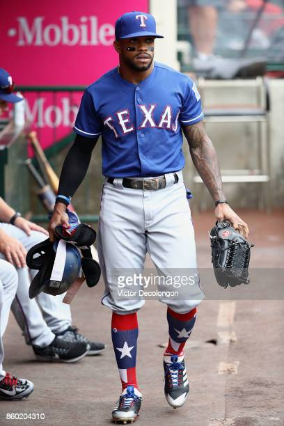 Delino DeShields of the Texas Rangers walks in the dugout prior to the MLB game against the Los Angeles Angels of Anaheim at Angel Stadium of Anaheim...