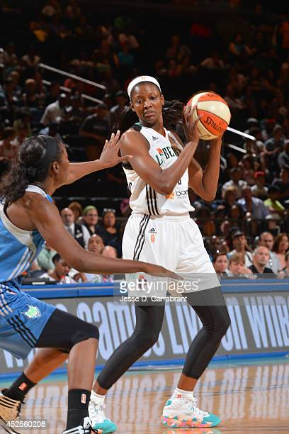 DeLisha Milton of the New York Liberty handles the ball against the Minnesota Lynx during the game on July 6 2014 at Madison Square Garden in New...