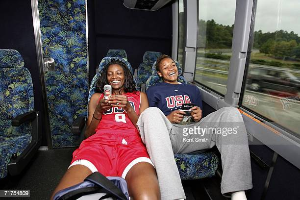 DeLisha MiltonJones and Alan Beard of the USA Basketball Senior Women's National Team have fun cutting up while traveling on the bus over to practice...