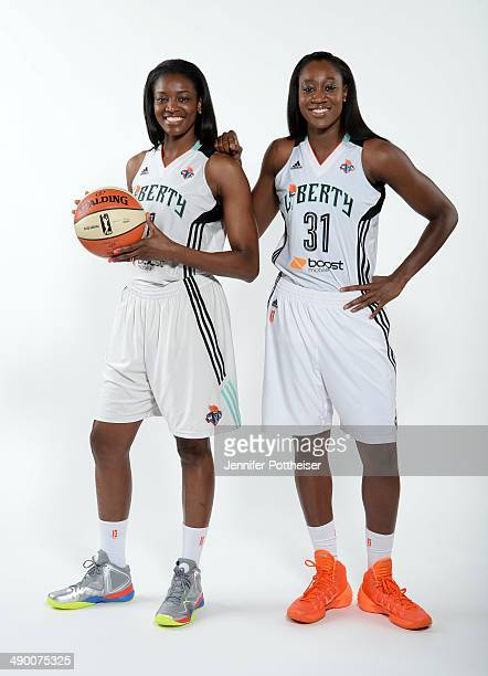 DeLisha MiltonJones and Tina Charles of the New York Liberty poses for a portrait during 2014 WNBA Media Day at the MSG Training Facility on May 12...