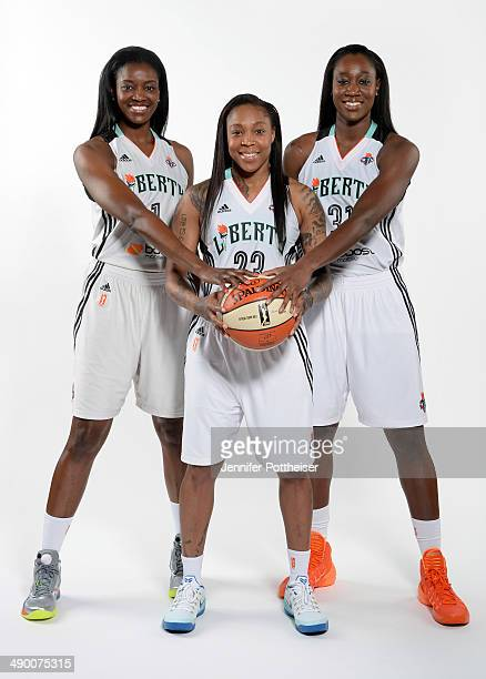 DeLisha MiltonJones Cappie Pondexter and Tina Charles of the New York Liberty poses for a portrait during 2014 WNBA Media Day at the MSG Training...
