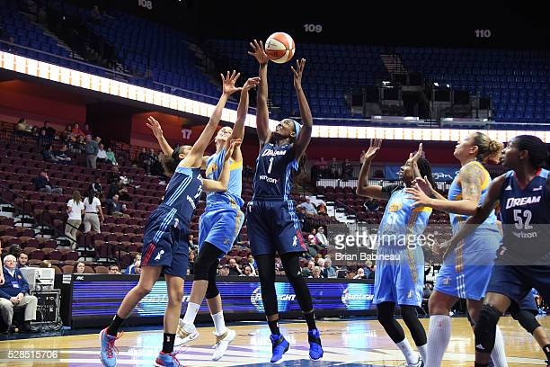 DeLisha MiltonJones of the Atlanta Dream goes up for a rebound against the Chicago Sky in a WNBA preseason game on May 5 2016 at the Mohegan Sun...