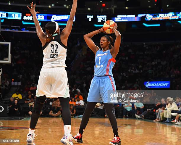 DeLisha MiltonJones of the Atlanta Dream looks to pass the ball against the New York Liberty at Madison Square Garden on August 21 2015 in New York...