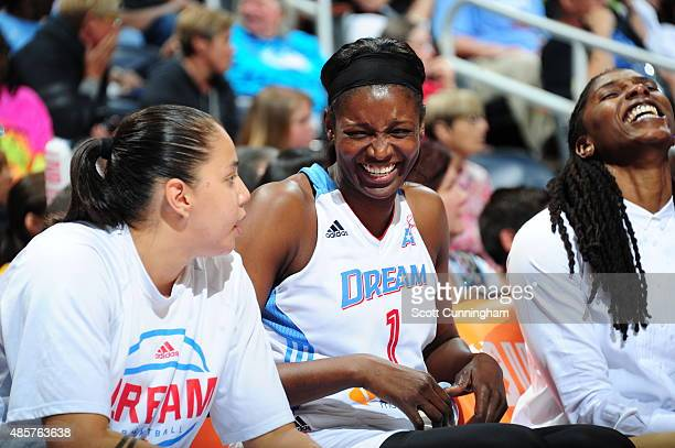 DeLisha MiltonJones of the Atlanta Dream shares a laugh with her teammates during a game agianst the Chicago Sky on August 29 2015 at Philips Arena...