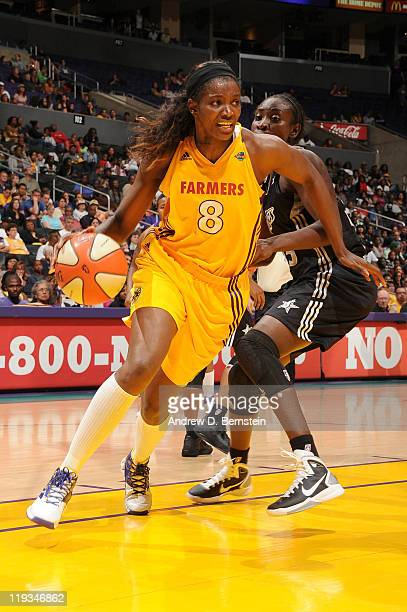 DeLisha MiltonJones of the Los Angeles Sparks drives to the basket against Sophia Young of the San Antonio Silver Stars at Staples Center on July 18...
