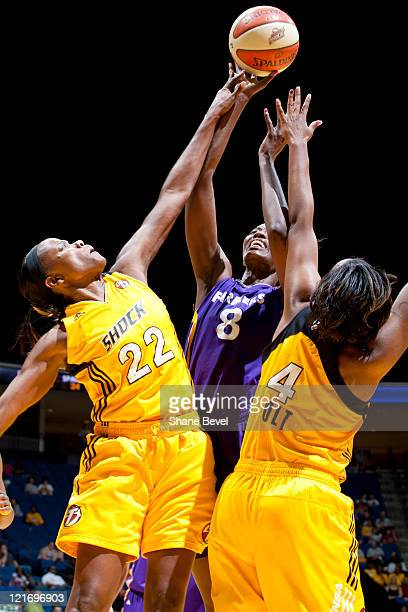 Delisha MiltonJones of the Los Angeles Sparks fires a shot over the guard of Sheryl Swoopes and Amber Holt of the Tulsa Shock during the WNBA game on...