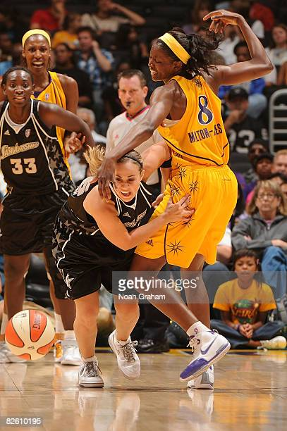 Delisha MiltonJones of the Los Angeles Sparks gets tangled up with Becky Hammon of the San Antonio Stars during the game at Staples Center on August...