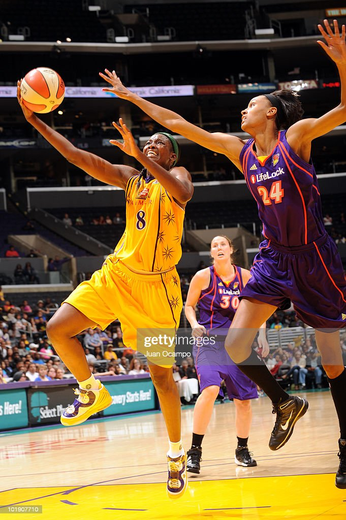 DeLisha MiltonJones of the Los Angeles Sparks goes to the basket against DeWanna Bonner#24 of the Phoenix Mercury on June 8 2010 at Staples Center in...