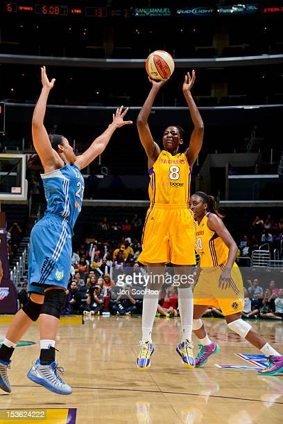 DeLisha MiltonJones of the Los Angeles Sparks shoots against Maya Moore of the Minnesota Lynx in Game Two of the WNBA Western Conference Finals at...