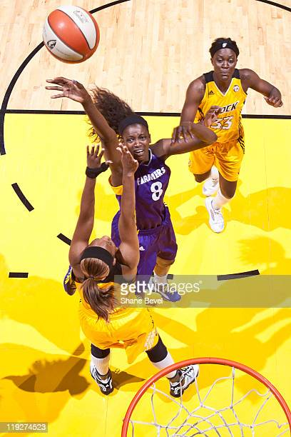 Delisha MiltonJones of the Los Angeles Sparks shoots over Amber Holt during the WNBA game on July 15 2011 at the BOK Center in Tulsa Oklahoma NOTE TO...
