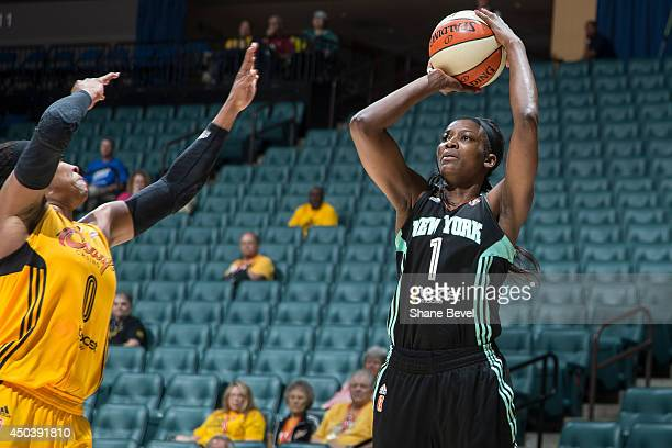 DeLisha MiltonJones of the New York Liberty shoots against the Tulsa Shock during the WNBA game on June 10 2014 at the BOK Center in Tulsa Oklahoma...
