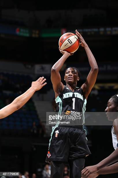 DeLisha MiltonJones of the New York Liberty takes a shot against the Minnesota Lynx on May 24 2014 at Target Center in Minneapolis Minnesota NOTE TO...
