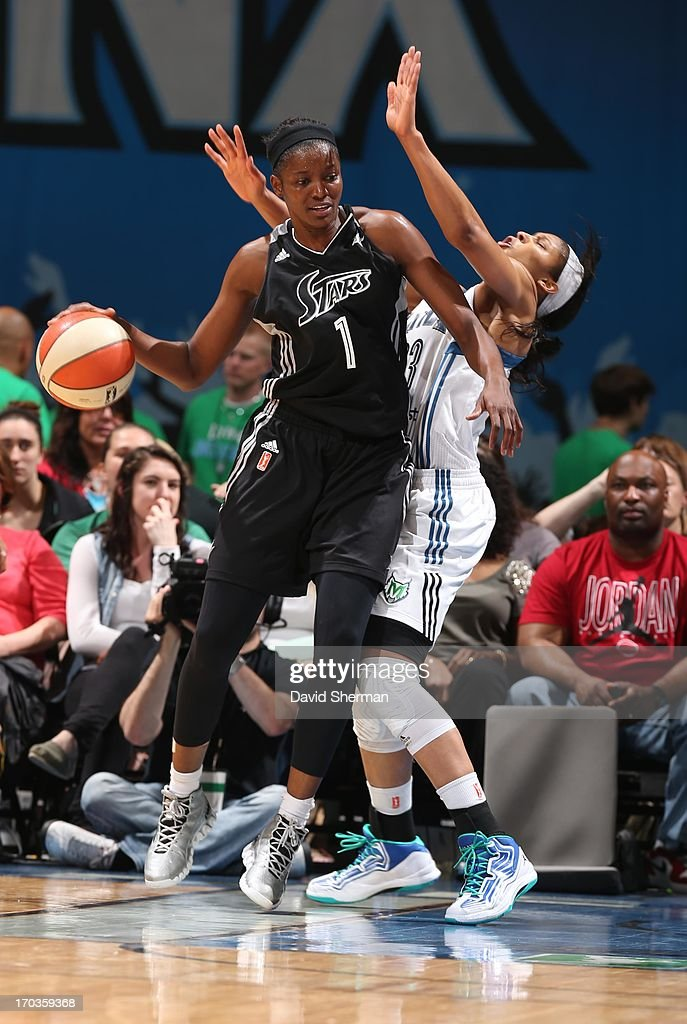 DeLisha Milton-Jones #1 of the San Antonio Silver Stars attempts to drive against Maya Moore #23 of the Minnesota Lynx during the WNBA game on June 11, 2013 at Target Center in Minneapolis, Minnesota.